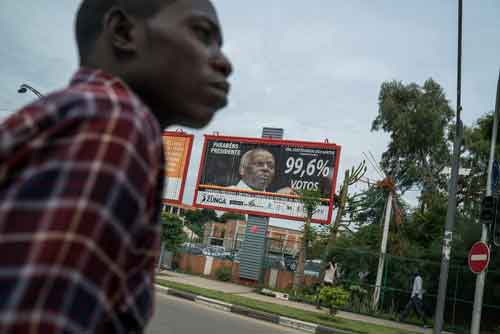 A billboard in Luanda, Angola, congratulating President José Eduardo dos Santos. He says he is stepping down after 38 years in office. Credit Joao Silva/The New York Times