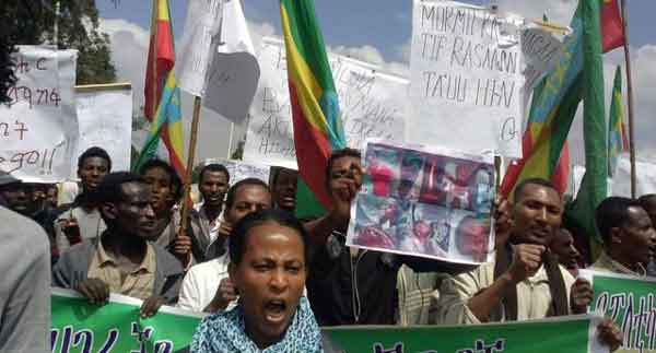 Photo: Protesters in Ethiopia's capital Addis Ababa (Finfinnee) demand that TPLF stop Killing Oromo students, and stop evicting Oromo farmers and grabbing their land. Credit: Caamsaa/May 24, 2014 · Finfinne Tribune | Gadaa.com