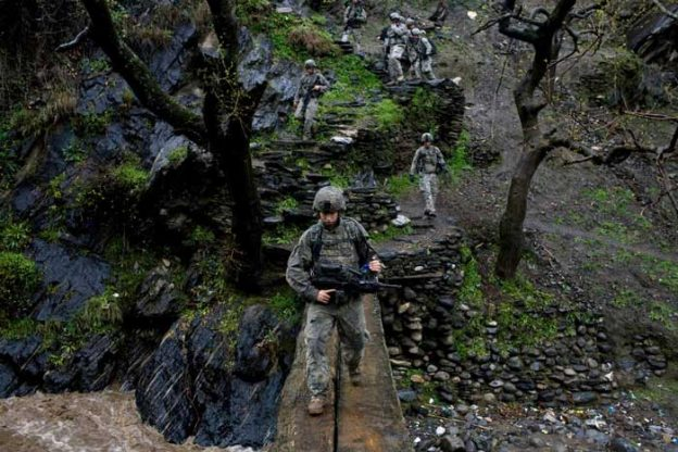 Pfc. Paul Landenberger, a soldier in Viper Company, on patrol in the Korengal Valley in April 2009.