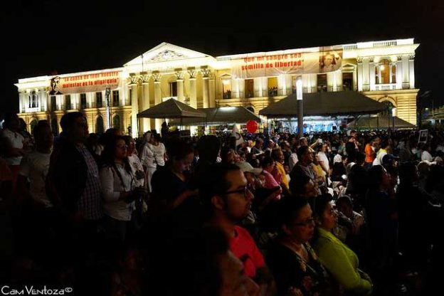 Photo: People gather in San Salvador awaiting the canonization of Archbishop Romero by Pope Francis at the Vatican. Credit: Cam Ventoza