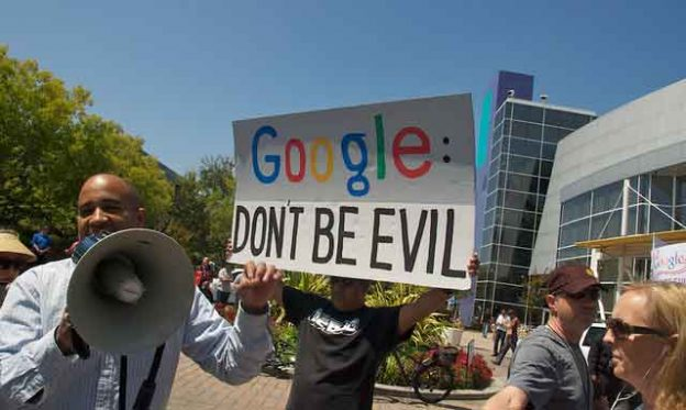 "Demonstration in front of Google headquarters on August 13, 2010 as Google seemed to shift away from its strong stance in favor of net neutrality. Google has since dropped its ""don't be evil"" clause from its code of conduct. The harm that Google and other internet companies may doing is coming under increasing scrutiny. Credit: Steve Rhodes"